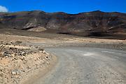 Unsurfaced road, barren rocky mountains, Jandia peninsula, Fuerteventura, Canary Islands, Spain