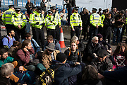 Extinction Rebellion peaceful disruption outside City Airport on 10th October 2019 in London, England, United Kingdom. The protest is against the climate and pollution impact of the government's plans for airport expansion which will potentially double the amount of flights coming from City Airport. Extinction Rebellion is a climate change group started in 2018 and has gained a huge following of people committed to peaceful protests. These protests are highlighting that the government is not doing enough to avoid catastrophic climate change and to demand the government take radical action to save the planet.