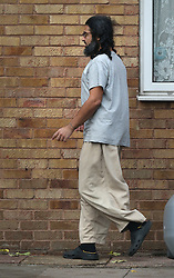 © Licensed to London News Pictures. 13/11/2015. London, UK.  Former Guantanamo detainee Shaker Aamer stands outside his home. Shaker Aamer was freed recently after being incarcerated in the US prison located in Cuba since 2002.  Photo credit: Peter Macdiarmid/LNP