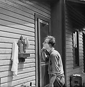 0613-N24 Sandy Pond, NY, man shaving outdoors.