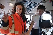 Nesrine performs a servere conrol of a plane.  At Roissy, Nesrine, 34, works as a technical inspector  for the DGCA (Directorate General of Civil Aviation) - she is the only female technical controller at the airport of Roissy-en-France. She can stop a Boeing taking off and make the 300 passengers leave the airplane. Nesrine Chkioua is the only woman controller at Roissy Airport and one of three women doing this job in France.<br /> <br /> <br /> À Roissy, Nesrine, 34 ans, exerce le métier de contrôleur technique (CTE) pour la DGAC (Direction générale de l'aviation civile) - elle est la seule femme contrôleur technique à l'aéroport de Roissy-en-France.  Elle peut immobiliser un Boeing, retarder le décollage et même faire débarquer les 300 passagers d'un long-courrier. Nesrine Chkioua est la seule contrôleur femme à Roissy aéroport et est une des trois femmes à exercer ce métier en France.