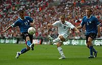 Photo: Tony Oudot.<br /> England v Estonia. UEFA European Championships Qualifying. 13/10/2007.<br /> Joe Cole of England gets in a shot past Enar Jaager and Aleksandr Dmitrijev of Estonia