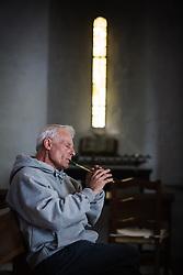 Man playing Irish tinwhistle, Ballintubber Abbey, County Mayo, Ireland