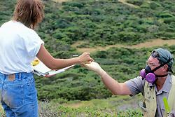 Dr Judd Howell Handing Item To Earthwatcher