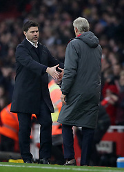 Arsenal manager Arsene Wenger, right shakes hands with Tottenham Hotspur manager Mauricio Pochettino, left at the end of the match