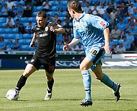 Photo: Steve Bond.<br />Coventry City v West Bromwich Albion. Coca Cola Championship. 28/04/2007. Jason Koumas (L) attacks David McNamee (R)