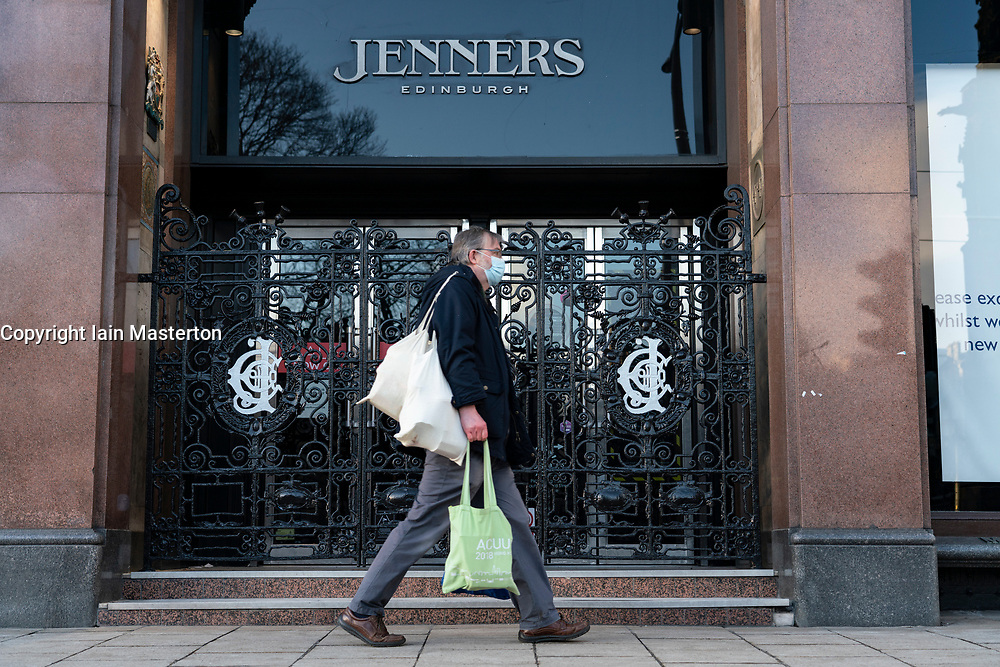 Edinburgh, Scotland, UK. 25 January 2020. Jenners department store on Princes Street in Edinburgh announces it is to close permanently on 3 May with loss of 200 jobs. Frasers, its owner, says it's failed to agree on rent with building owner Anders Polvsen. Pic; member of the public walks past  closed Jenners store today. Iain Masterton/Alamy Live News