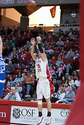 26 February 2006:  Megan McCracken drains a 3 pointer.....Illinois State Redbirds out muscled the Creighton Bluejays on Senior day by a score of 75-61.  Senior Holly Hallstorm grabbed her 10th double double with 20 points and 12 rebounds.  Competition took place at Redbird Arena on Illinois State University campus in Normal Illinois.