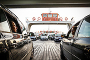 Two ladies talk from inside their cars with each other during the boat trip from Cacilhas to Belém (Lisbon)<br /> Credit: Rodrigo Cabrita/4SEE