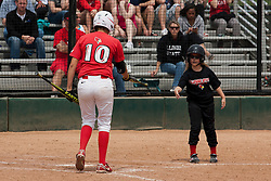 15 April 2012:  Laura Canopy hands a bat to the bat girl during an NCAA women's softball game between the Drake Bulldogs and the Illinois State Redbirds on Marian Kneer Field in Normal IL