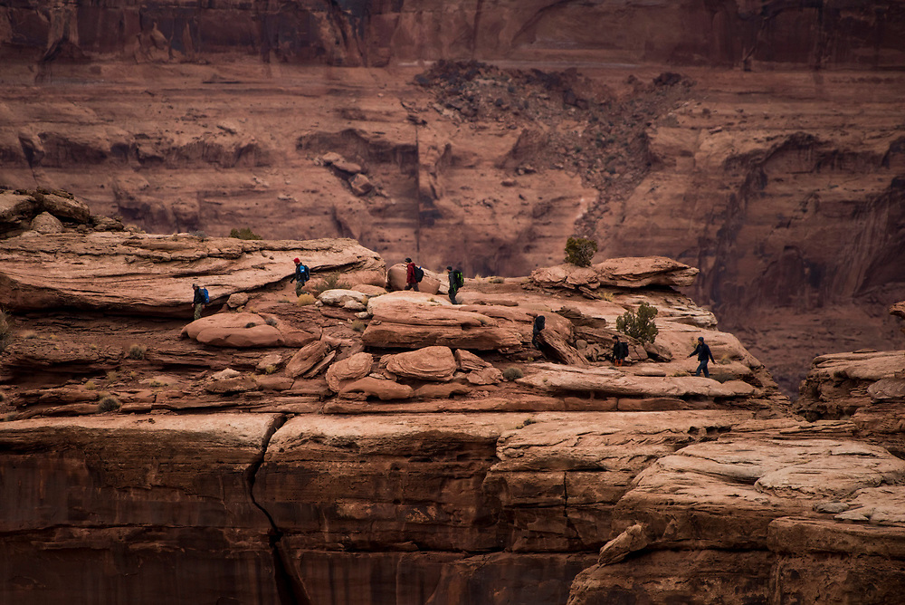 BASE jumpers hike to their exit point at Mineral Bottom, in Utah.