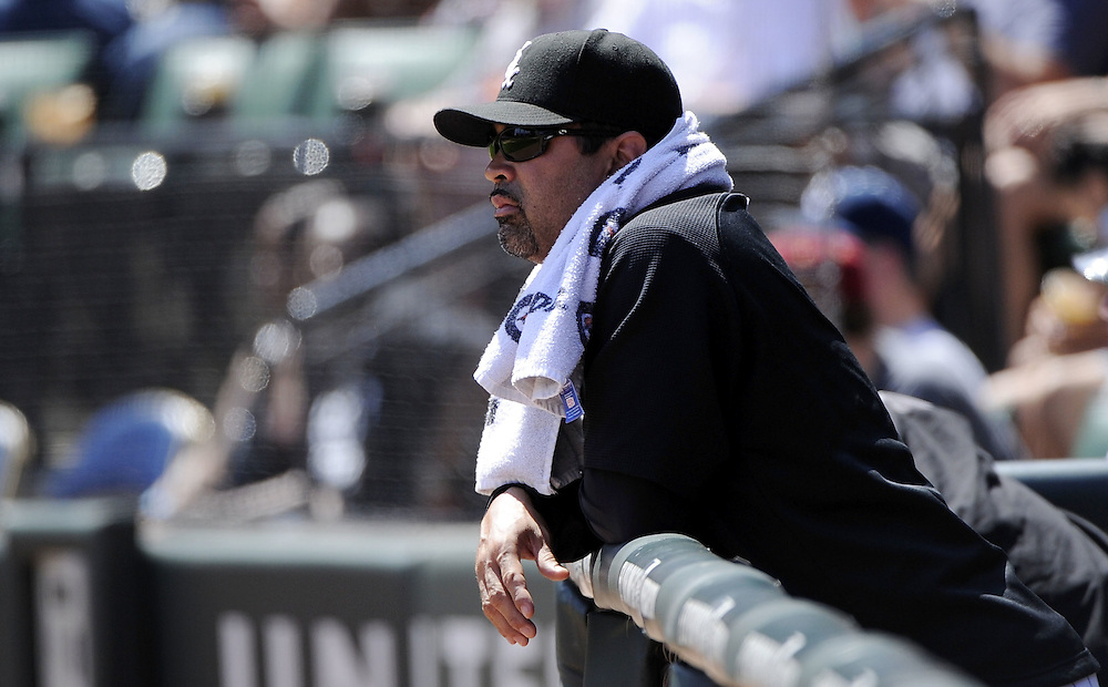 CHICAGO, IL - JUNE 26:  Manager Ozzie Guillen #13 of the Chicago White Sox looks on against the Washington Nationals on June 26, 2011 at U.S. Cellular Field in Chicago, Illinois.  The Nationals defeated the White Sox 2-1.  (Photo by Ron Vesely/MLB Photos via Getty Images)  *** Local Caption *** Ozzie Guillen