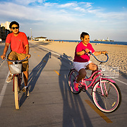 Patricia Gonzalez-Portillo and her son, Alan, ride their bikes and stroll along the beach near their Long Beach, CA home on Friday, July 12, 2017. Patricia, who enjoys being close to the beach, is considering leaving California so she can afford Alan's looming college education.