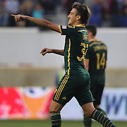 Maximiliano Urruti. Portland Timbers, celebrates after scoring the first of his two goals during the New York Red Bulls Vs Portland Timbers, Major League Soccer regular season match at Red Bull Arena, Harrison, New Jersey. USA. 24th May 2014. Photo Tim Clayton