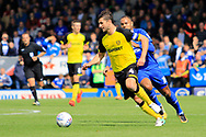 Burton Albion defender John Mousinho (4) and Cardiff City striker Kenneth Zohore (10) during the EFL Sky Bet Championship match between Burton Albion and Cardiff City at the Pirelli Stadium, Burton upon Trent, England on 5 August 2017. Photo by Richard Holmes.