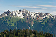 Fresh snow dusts the North Cascade Mountain peaks of Nooksack Ridge, in Mount Baker Wilderness, Washington, USA. Photographed near Austin Pass Visitors Center on the Chain Lakes Loop Trail below Artist Point.
