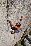"Brad Parker climbing ""Spinal Tap"" (5.11b) at Chipmonk Flat, Sonora Pass, Sierra Nevada Mountains, California"
