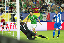 July 20, 2017 - Glendale, Arizona, U.S - Mexico's RODOLFO PIZARRO (15) shoots and scores a goal in the first half against Honduras's goalie LUIS LOPEZ (1) Thursday, July 20, 2017, during the 2017 Gold Cup Quarterfinals at University of Phoenix Stadium in Glendale, Arizona. (Credit Image: © Jeff Brown via ZUMA Wire)