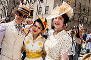 New York, NY - April 16, 2017. Two women and a man elaborately dressed  at New York's annual Easter Bonnet Parade and Festival on Fifth Avenue.