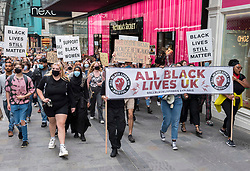 "© Licensed to London News Pictures; 06/09/2020; Bristol, UK. An All Black Lives UK ""Comeback March"" and rally takes place through Bristol city centre. Organisers of the Bristol protest have encouraged people to bring PPE (personal protective equipment). The All Black Lives group is youth-led and is separate to the Black Lives Matter movement, but both are united in striving for racial equality. All Black Lives UK are holding 'Comeback Marches' at several locations across the country today, including London, Bristol and Manchester, and have issued a series of demands: to end racial discrimination in the criminal justice, reform the education system, end racial health disparities, implement review recommendations, and stand with the Black community in the US. In Bristol the statue of slave trader Edward Colston was pulled down with ropes and thrown into Bristol docks on 07 June during an All Black Lives/Black Lives Matter protest that made headlines around the world. A month later in July a new sculpture titled ""A Surge of Power (Jen Reid) 2020"" by artist Marc Quinn was put up without permission from Bristol City council. Jen Reid was at the previous protest on 07 June which was in protest for the memory of George Floyd, a black man who was killed on May 25, 2020 in Minneapolis in the US by a white police officer kneeling on his neck for nearly 9 minutes. The killing of George Floyd has seen widespread protests in the US, the UK and other countries. Photo credit: Simon Chapman/LNP."