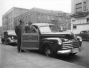 """Ackroyd 00078-48. """"Western Skyways. March 21, 1947. Station wagon."""" Parked in front of Wolfard Motor Co., 1207 West Burnside. Across the street from the Crystal Hotel. Mecca Hotel sign."""