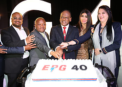 Business man Vivian Reddy celebrating 40th birthday of his compny Edisons power existence at the ICC. He is cutting the cake surrounded by his son Kuber Reddy, MEC Sihle Zikalala, his wife Sorisha and MEC Belinda Scott<br /> Pic