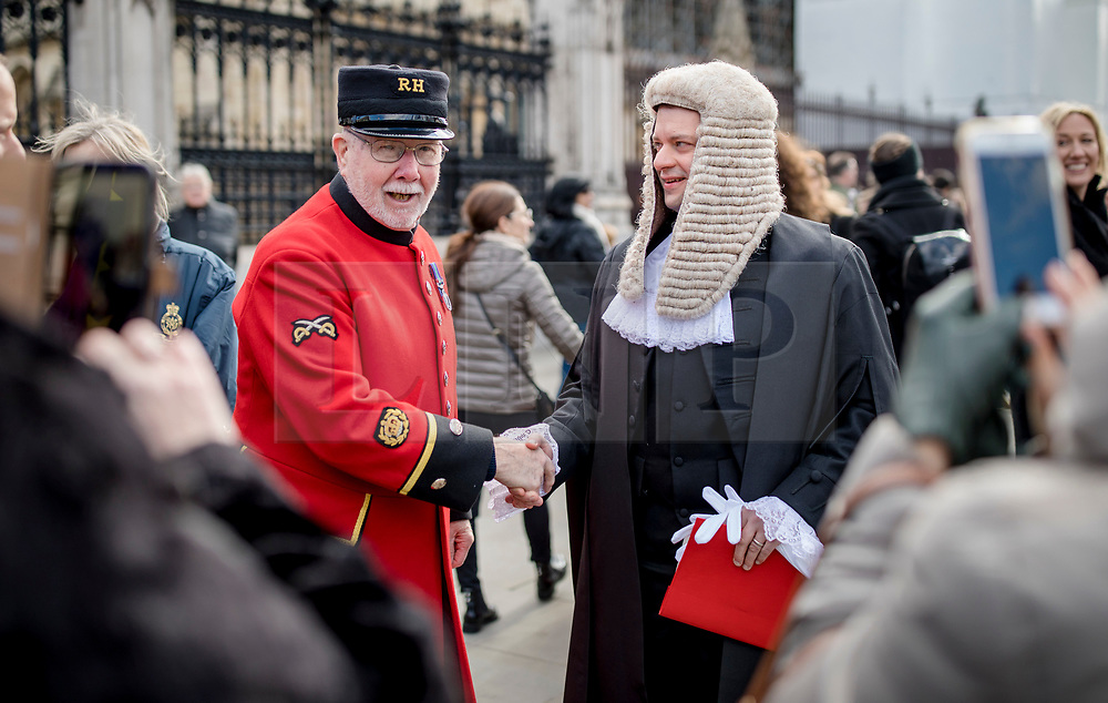 © Licensed to London News Pictures. 11/03/2019. London, UK. A Chelsea Pensioner poses for a photograph with a newly-appointed QC outside the Palace of Westminster after the Silks Ceremony, in which new QCs are formally appointed. Photo credit: Rob Pinney/LNP