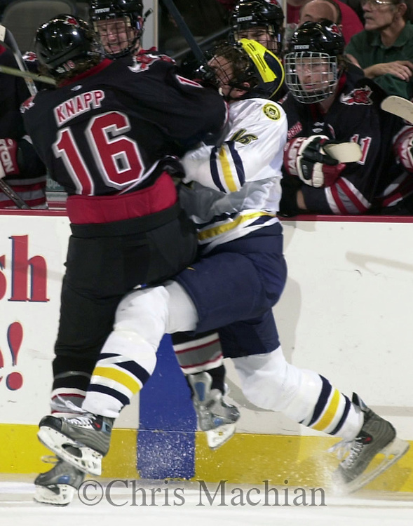 CM-12/13/03 Omaha, NE UNO's Dan Knapp gives Michigan's David Rohlfs a faceful of Maverick  during the second period Saturday night at the Qwest Center Omaha. (photo by Chris Machian/Prairie Pixel Group)