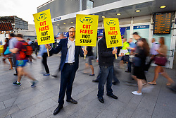 © Licensed to London News Pictures. 16/08/2016. London, UK. Members of rail unions campaign outside London Bridge Station in London on Tuesday, 16 August 2016. Photo credit: Tolga Akmen/LNP