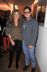 KELLY HOPPEN and ALAN CARR at a party to celebrate the launch of 'Interiors by Yoo' - a book by John Hitchcox, Philippe Starck, Kelly Hoppen, Jade Jagger and Marcel Wanders held at Selfridges, 400 Oxford Street, London on 3rd December 2009.
