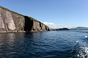 Spectacular cliff faces in The Atlantic Ocean in Dingle Bay in County Kerry.<br /> Photo: Don MacMonagle