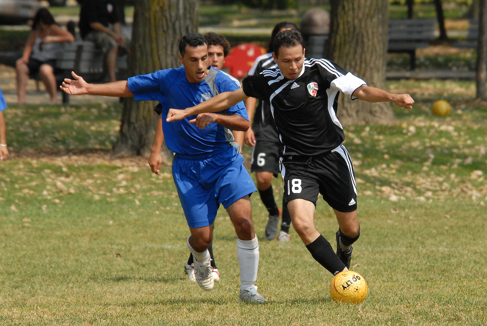 Rodrigo Gomez (#18) of Deportivo Colomex makes a breakaway while competing with Team Shlama F.C. during National Soccer League play in Skokie, Il.  .