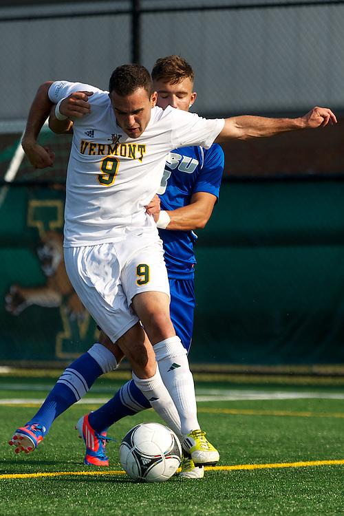 Catamounts forward Zach Paul (9) battles for the ball during the men's soccer game between the Central Connecticut State University Blue Devils and the Vermont Catamounts at Virtue Field on Friday afternoon September 7, 2012 in Burlington, Vermont.