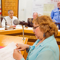 031413       Cable Hoover<br /> <br /> Linda Garcia signs her oath of office after being sworn in as a city councilor at Gallup City Hall Thursday.