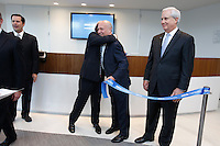 Francisco Gonzalez, left, hugging Manolo Sanchez following a ribbon cutting at the BBVA grand opening in Houston.