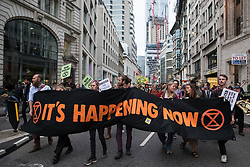 London, UK. 2nd September, 2021. Environmental activists march out of the City of London after blockading the Bank of England on the eleventh day of their Impossible Rebellion protests. The activists included over fifty wearing signs indicating that they were breaking restrictive bail conditions by entering the City of London. Extinction Rebellion are calling on the UK government to cease all new fossil fuel investment with immediate effect.