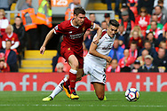 James Milner of Liverpool gets in front of Matthew Lowton of Burnley. Premier League match, Liverpool v Burnley at the Anfield stadium in Liverpool, Merseyside on Saturday 16th September 2017.<br /> pic by Chris Stading, Andrew Orchard sports photography.