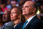 """Chancellor Harold L. Martin Sr. and wife Davida Wagner Martin listen as master communicator, multidimensional businessman and international thought leader T.D. Jakes speaks about """"Living Your Best Life"""" at North Carolina Agricultural and Technical State University's spring Chancellor's Speaker Series on Thursday, April 11, 2019.<br /><br />(Chris English/Tigermoth Creative)"""
