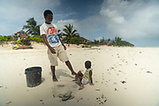 Local fisherman and young boy with an octopus, East Coast, Zanzibar