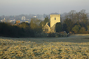 St Botophs Parish Church, Barton Seagrave Northamptonshire, seen from 'The Spinney' on a frost winter morning..looking across the valley in the pirate ship ride at Wicksteed Park