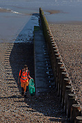 June 3, 2015 - Hastings, England, UK - A casual worker cleans debris that are brought by the waves of the sea to the coast of Hastings. (Credit Image: © Vedat Xhymshiti/ZUMA Wire)