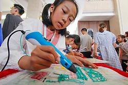 May 5, 2018 - Hunan, Hunan, China - Hunan, CHINA-5th May 2018: Kids experience technology of robot at a youth robot festival held in Longhui County, central China's Hunan Province. (Credit Image: © SIPA Asia via ZUMA Wire)