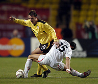 Fotball<br /> Champions League 2004/05<br /> Monaco v Liverpool<br /> 23. november 2004<br /> Foto: Digitalsport<br /> NORWAY ONLY<br /> Liverpool's Dietmar Hamann (L) comes unstuck against Monaco's Andreas Zikos