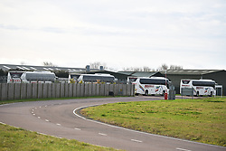 © Licensed to London News Pictures. 31/01/2020. Brize Norton, UK. Coaches are seen arriving at RAF Brize Norton in Oxfordshire before a plane carrying Britons from Wuhan in China arrives. A flight, carrying 150 Britons and 50 people from elsewhere in the EU from the centre of the coronavirus outbreak, was initially delayed because of a lack of clearance by Chinese Authorities. Photo credit: Ben Cawthra/LNP