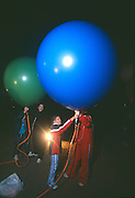 John Ninomiya, a cluster balloonist gets help from volunteers at Coalinga, California.