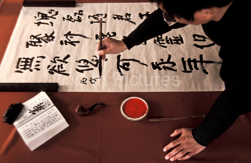 Calligrapher at work in his Beijing studio, keeping alive an ancient traditional art form which is still much revered in China.