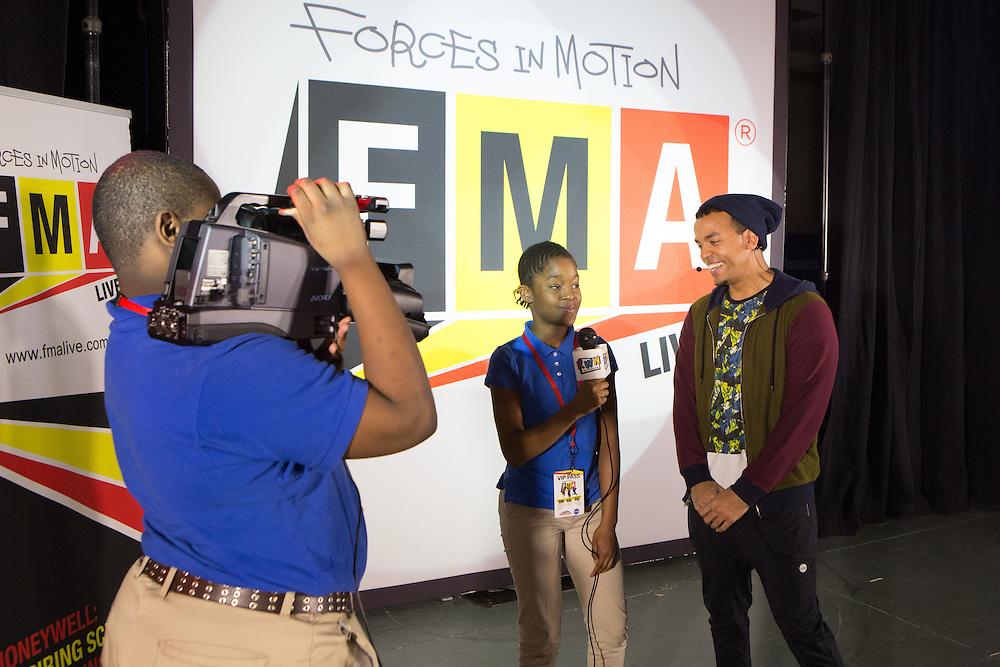 Students DeAndre Stevenson and Saiah Tagoe interview performer John James as Honeywell and NASA bring hip-hop physics educational series to the Quitman Street Community School in Newark. <br /> <br /> 3/19/2015 Photo by John O'Boyle<br /> www.johnoboylevisuals.com<br /> john@johnoboyle.com