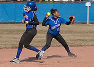 Middletown, New York - The  Middletown shortstop throws the ball to first base after forcing a runner out at second during a varsity girls' softball game on April 9, 2014.