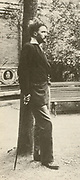 'Ezra Weston Loomis Pound (1885-1972)  American expatriate poet, critic and a major figure of the early modernist movement. standing in a Paris garden.'