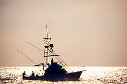 sport fishing boat, trolling at sunset, Kona, Big Island, Hawaii, USA, Pacific Ocean